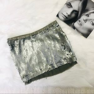 Plain Sud Silk and Sequin mini skirt.